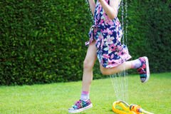 Summer fun with water sprinkler royalty free stock photos