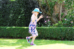 Summer fun with water sprinkler Royalty Free Stock Photography