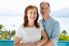 Summer fun weekends at tropical beach. Happy middle aged family couple on nature sea background. Healthy relationship and love. Summertime travel concept. Close royalty free stock photo