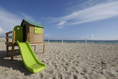 Summer games. Detail of a children playground hut on Cagliari's Poetto beach, shot on an average winter day Royalty Free Stock Photography