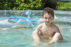 In summer, the garden is bathed in an inflatable pool boy. Royalty Free Stock Photos