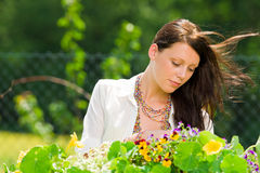 Summer garden beautiful woman care color flowers Royalty Free Stock Image