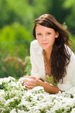 Summer garden beautiful woman care white flowers Stock Photography