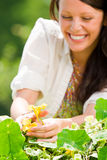 Summer garden beautiful woman smiling care flower Stock Photography