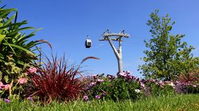 Summer Garden With Cable Car And Bloom flowers. Colorful Garden Blooming Flower With Cable Car And Blue Sky In Summer.Berlin Germany Stock Photography