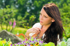 Summer garden flowers beautiful woman dreamy look Stock Image
