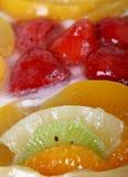 Summer garden fruits in a sweet glazed cream pie dessert royalty free stock image