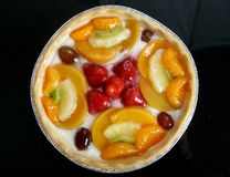 Summer garden fruits in a sweet glazed cream pie dessert stock images