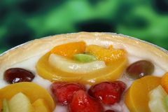 Summer garden fruits in a sweet glazed cream pie dessert Royalty Free Stock Photo