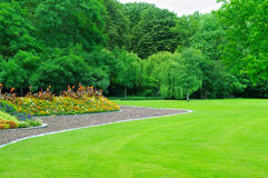 Garden with lawn and flower garden. Summer garden with lawn and flower garden royalty free stock images
