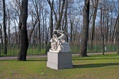 The Summer Garden in Saint-Petersburg. Russia. SAINT - PETERSBURG, RUSSIA - MAY 11, 2017: Cupid and Psyche Sculpture Group in The Summer Garden. The Summer Stock Image