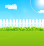 Summer garden scene with wooden fence and blue sky - Useful as b Stock Photography