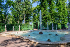 The summer garden in St. Petersburg. The fountain in . Old Park. Historical landmark of St. Petersburg. Green Park with beautiful fountains royalty free stock photography