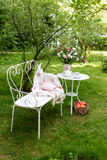 Summer garden with tea party setting. Outdoor decorations. Royalty Free Stock Image