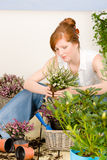 Summer garden terrace redhead woman potted flower. Summer garden terrace redhead woman hold potted flower royalty free stock image