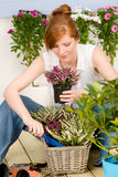 Summer garden terrace redhead woman potted flower. Summer garden terrace redhead woman hold potted flower Stock Image