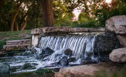 Summer Garden With a Waterfall Royalty Free Stock Images