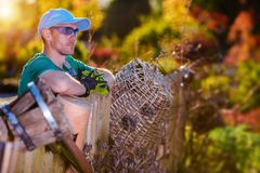 Summer Garden Work. Satisified Caucasian Gardener Overlooking His Garden stock photography