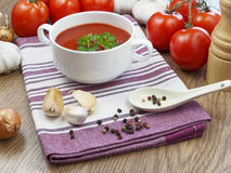 Summer gazpacho soup with vegetables. On wooden table Royalty Free Stock Image