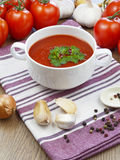 Summer gazpacho soup with vegetables. On wooden table Royalty Free Stock Images