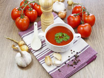 Summer gazpacho soup with vegetables. On wooden table Royalty Free Stock Photo