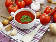 Summer gazpacho soup with vegetables. On wooden table Stock Images