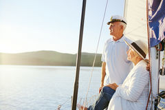 Summer getaway. Retired women and men having rest on yacht Royalty Free Stock Image