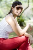 Summer Girl. A young sporty girl sitting outside wearing sunglasses stock photos