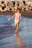 Summer girl. Happy girl running by the ocean Stock Photography