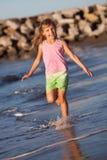 Summer girl. Happy girl running by the ocean Stock Photos