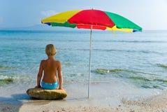 Summer girl. Girl under umbrella on the beach Stock Photography