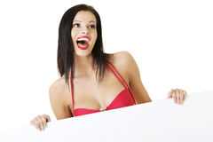 Summer girl in bikini holding blank board Stock Photo
