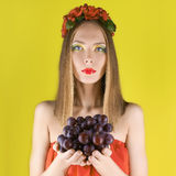 Summer girl with bunch of grapes Stock Image