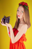 Summer girl with bunch of grapes Royalty Free Stock Photography