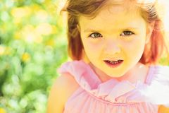 Summer girl fashion. Happy childhood. Little girl in sunny spring. Springtime. face and skincare. allergy to flowers stock photos