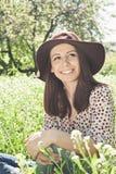 Summer girl in a garden Stock Photos