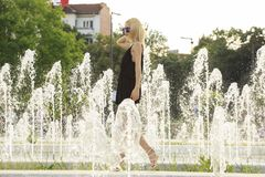 Summer girl in the glasses near Fountain Royalty Free Stock Photography