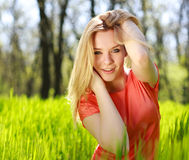 Summer girl in green grass Royalty Free Stock Photography