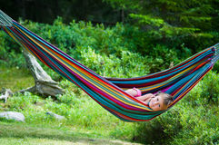 Summer girl in hammock conversating by cell phone Stock Images