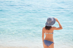 Summer girl with a hat at the beach Stock Photo