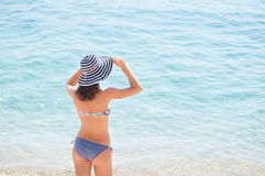 Summer girl with a hat at the beach Stock Photos