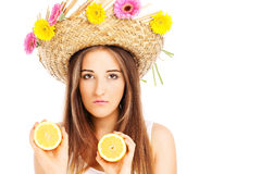 Summer girl in a hat with flowers and lemons Royalty Free Stock Images