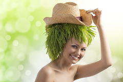 Summer girl with hat and grass on head Stock Photos