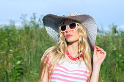 Summer, the girl in the hat Stock Images