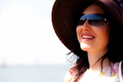 Summer girl with hat and sunglasses. Young women with summer hat and summer glasses smiling Royalty Free Stock Photography