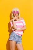 Summer girl holding finger on her lips Royalty Free Stock Photography