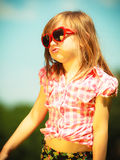 Summer. Girl kid child in red sunglasses outdoor Royalty Free Stock Image