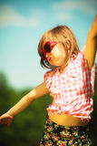 Summer. Girl kid in red sunglasses playing outdoor Stock Photos