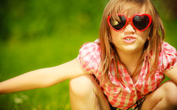Summer. Girl kid in red sunglasses playing outdoor Stock Photography