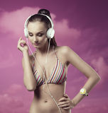 Summer girl listening music Stock Photography